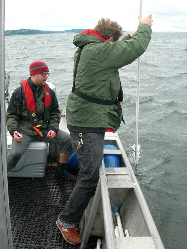 Study coauthors Jimmy O'Donnell, right, and Ryan Kelly take a water sample from Puget Sound for environmental DNA analysis.