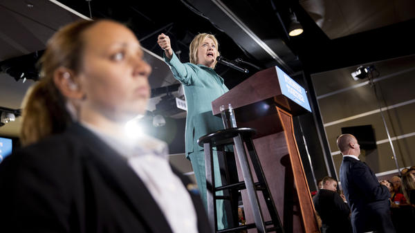 Members of the Secret Service stand guard near Democratic presidential candidate Hillary Clinton in August as she speaks at a rally at International Brotherhood of Electrical Workers Local 357 Hall in Las Vegas.