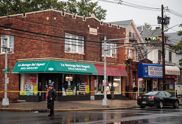 A local police officer stands guard at an intersection as members of the FBI and other law enforcement agencies investigate a residence near the Rahami family's restaurant, First American Fried Chicken, in Elizabeth, N.J., on Monday.