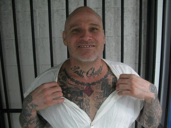 James Burns shows off his Last Chance tattoo.