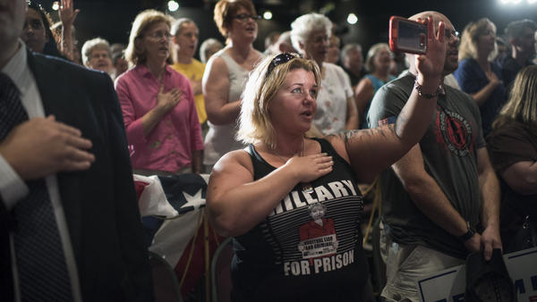 Brandie Seagrove of Harrisburg, Pa., recites the Pledge of Allegiance before Republican vice presidential nominee Mike Pence, spoke during a campaign rally in Lancaster, Pa.