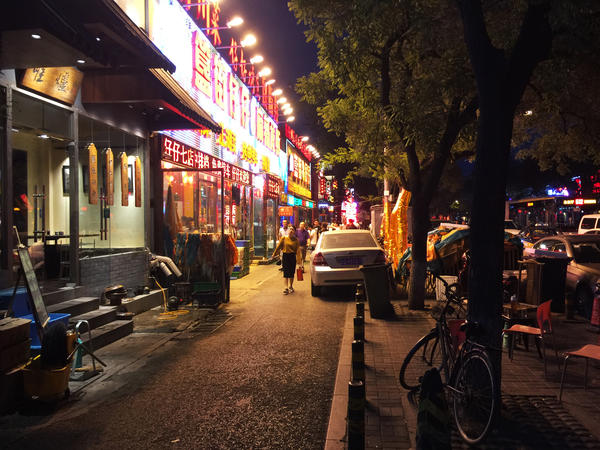 Restaurants stay open late into the night on Beijing's Dongzhimennei Street, including A Very Long Time Ago, which reintroduced the practice of tipping waitstaff last October.
