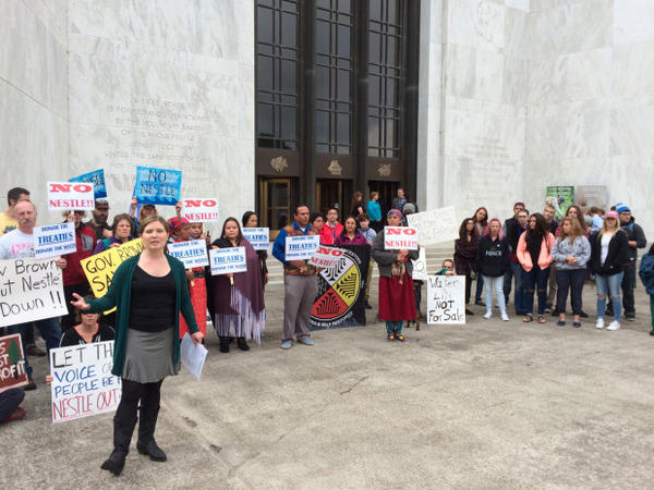 <p>Julia DeGraw of Food & Water Watch speaks during a protest at the Oregon State Capitol against a water exchange that opponents say will pave the way for Nestle to revive its proposal to built a bottling plant in the Columbia River Gorge.</p>