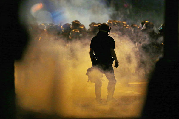 Police fire tear gas on Wednesday as protesters converge on downtown Charlotte, N.C. Two nights of unrest followed the fatal police shooting of Keith Lamont Scott on Tuesday.