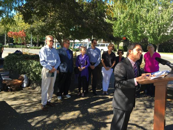 Republican state Sen. Mark Miloscia gives a press conference in front of a small group of homeless people. Miloscia says the homeless need more supervision.