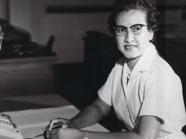 "<a href=""http://www.nasa.gov/sites/default/files/thumbnails/image/katherine_johnson_john_glenn.png""></a>Katherine Johnson sits at her desk with a globe, or ""Celestial Training Device."""