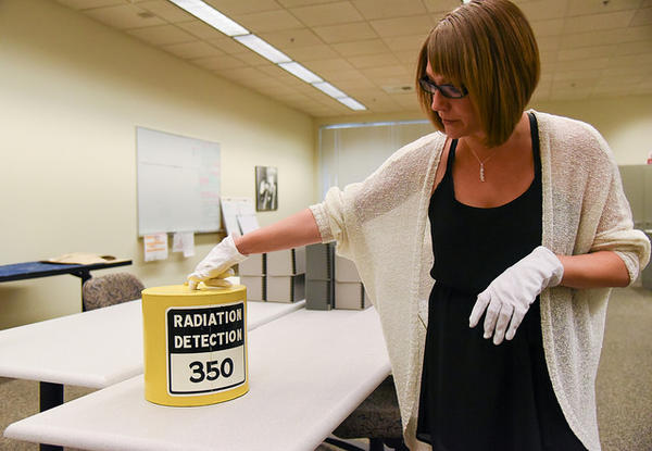 Jillian Gardner-Andrews, project coordinator for the Hanford History Project, works to organize and curate thousands of artifacts from Hanford that will be added to a new public collection at Washington State University Tri-Cities in Richland.