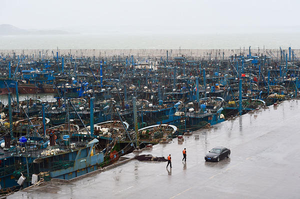 Fishing boats packed a port in Shishi, Fujian province, on Tuesday. Reuters reported that the province's 31,700 fishing boats were recalled to port because of high winds.