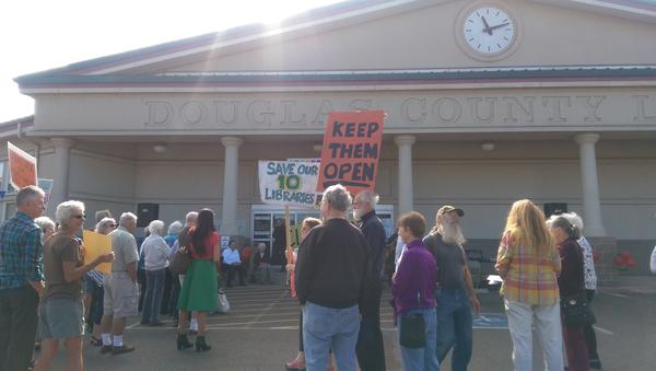 Supporters of measure 10-145 at a rally in front of the library in Roseburg.