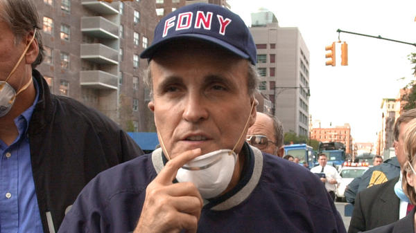 New York City Mayor Rudy Giuliani tours the site of the World Trade Center disaster on Sept. 12, 2001.