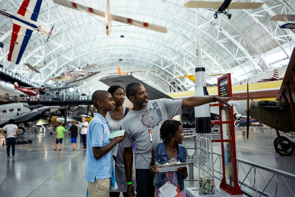 "The Brown family (left to right) — Malachi, 12; Lisa Nelson-Brown; Will; and Maiyah, 7 — €""go on a scavenger hunt at the museum sleepover."