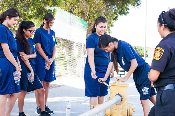 Gail Sonoda (right), an instructor and firefighter with the Los Angeles Fire Department, teaches young cadets how to work a hydrant.