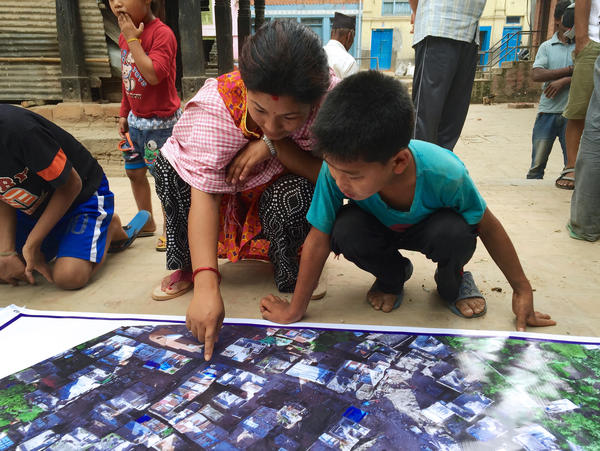 In Nepal, Meier printed out banners showing high-resolution maps from stitched-together drone images. People in Panga, near Kathmandu, had the opportunity to annotate the maps with additional information and fill in blank spots.