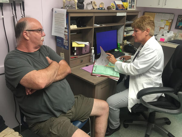 St. Petersburg resident Philip Ertel visits Dr. Trudy Grossman at the St. Pete Free Clinic for refills on his diabetes and cholesterol and medications.