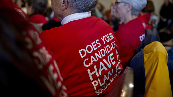 Attendees wear t-shirts in support of presidential candidates committing to Social Security for all generations during a town hall meeting in Cedar Rapids, Iowa, on Jan. 29.