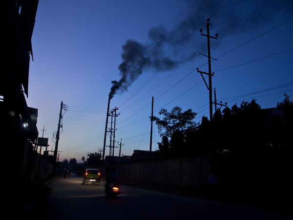 The smokestack of a factory on the outskirts of Gauhati, India, on Sunday.