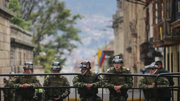 Presidential guard soldiers keep watch during the referendum on a peace accord to end the five-decade-long guerrilla war between the FARC and the state on Sunday in Bogota, Colombia. Colombian voters rejected the peace deal in a very close vote.