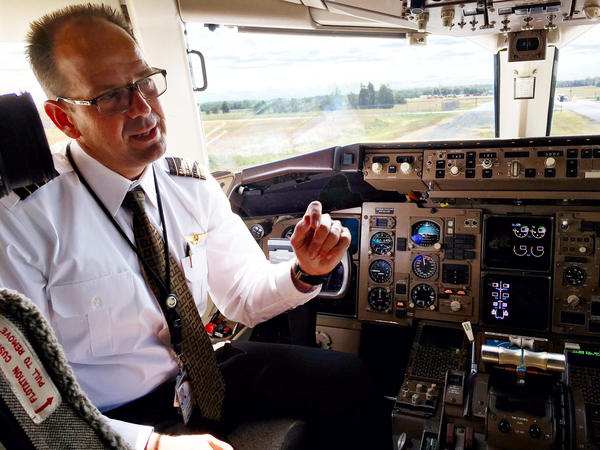 """UPS pilot Capt. Gregg Kastman says """"a lot of the messaging we used to have to receive via voice"""" over the radio includes route clearance, route changes and frequency changes."""