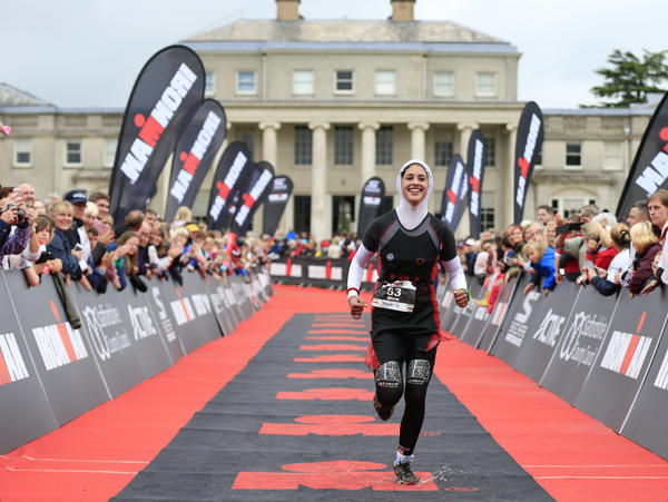 Gerami at the finish line of the half Ironman triathlon in Staffordshire.