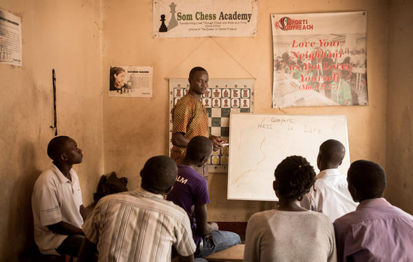 Robert Katende teaches a class at the Katwe Chess Academy, which he founded in 2003.