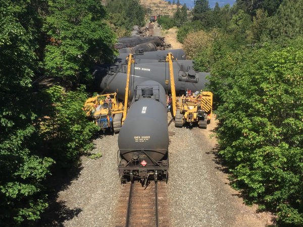 File photo. A train carrying crude oil from North Dakota derailed in the Columbia River Gorge near Mosier, Oregon, in June.