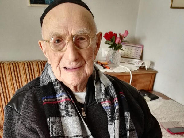 Yisrael Kristal sitting in his home in Haifa. Israel. Kristal is a Holocaust survivor and the world's oldest man, according to Guinness World Records. He celebrated his long-delayed bar mitzvah this week at the age of 113.