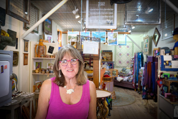 Kathleen Jardin owns Methow Valley's Central Reservations and an art gallery. She says she's hoping more people return to the valley for family vacations, reunions and weddings.