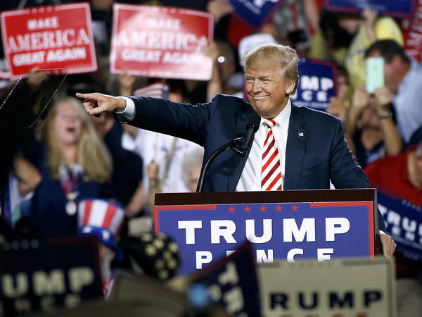 Republican presidential nominee Donald Trump points out to the crowd of supporters as he arrives at a campaign rally on Oct. 4, 2016 in Prescott Valley, Arizona.