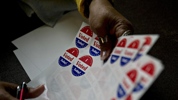 "A poll worker organizes ""I Voted Today"" stickers at the Francis Myers Recreation Center polling location in Philadelphia, Pa., on April 26."