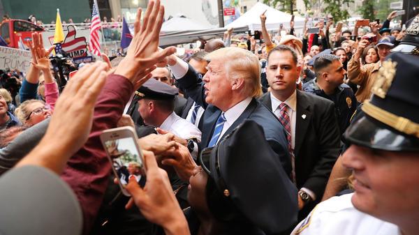 Donald Trump outside Trump Towers in Manhattan Saturday.