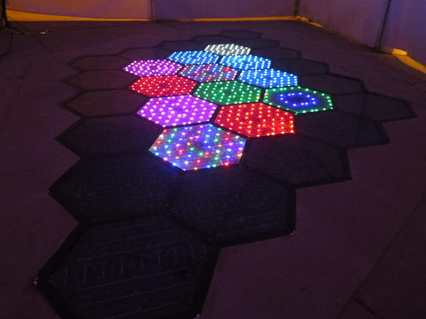 At night, small LED bulbs embedded in the Solar Roadways panels can be programmed to flash colorful patterns or display lane markings and signs.