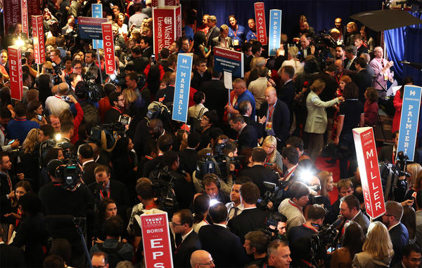 Reporters interview surrogates following the presidential debate at Washington University.
