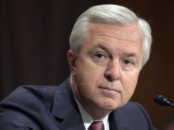 Wells Fargo CEO John Stumpf testifies before the Senate Banking Committee in September. Stumpf is resigning effective immediately in the aftermath of the bank's sales tactics scandal.