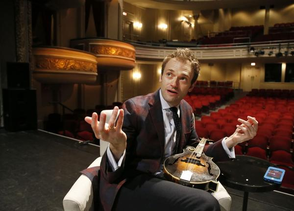 "Chris Thile at the Fitzgerald Theater in St. Paul, Minn. Thile is replacing Garrison Keillor as host of ""A Prairie Home Companion"" after Keillor retired this summer. (Ann Heisenfelt/AP)"