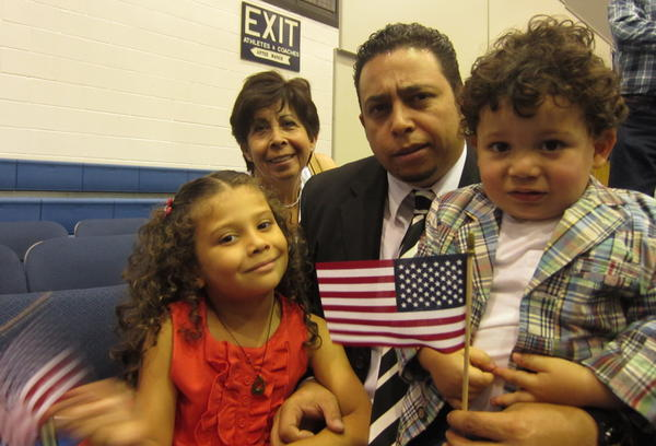 Luis Diaz is surrounded by his family after his naturalization ceremony.