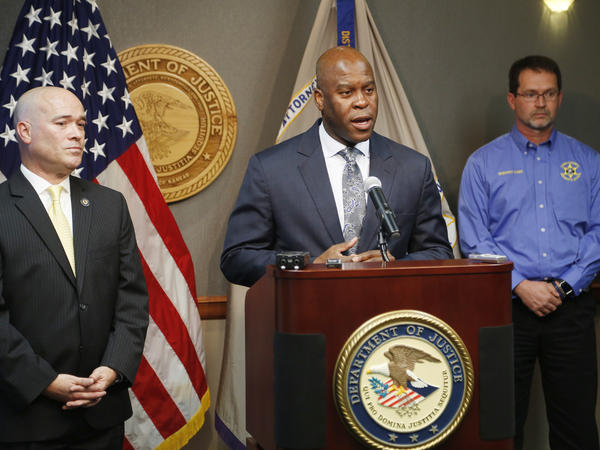 FBI Special Agent in Charge Eric Jackson announces the arrest of three members of a Kansas militia group that planned to bomb an apartment complex in Garden City, Kansas, where Somali families live. He is joined by Acting U.S. Attorney Tom Beall, left, Friday, Oct. 14.