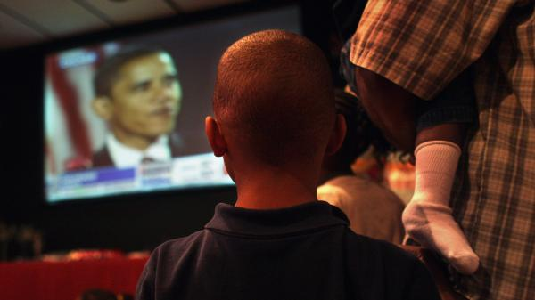 Quentyn Israel, 6, watches with his father and siblings as President-elect Barack Obama gives his victory speech on Nov. 4, 2008, in Denver, Colo.