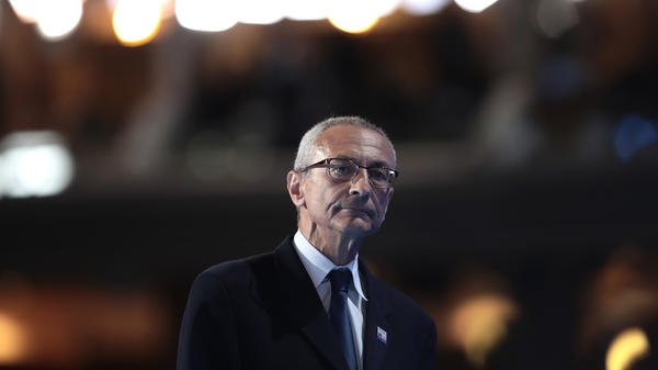 John Podesta walks off stage after delivering a speech on the first day of the Democratic National Convention July 25 in Philadelphia.