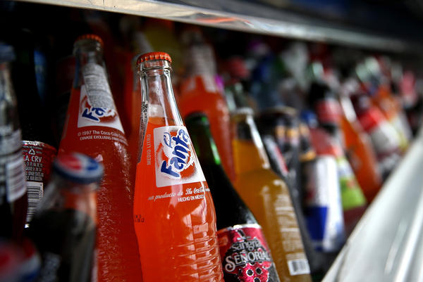 Bottles of Fanta are displayed in a food truck's cooler in 2014 in San Francisco. The city is one of several in California that have a soda tax on the ballot this November.
