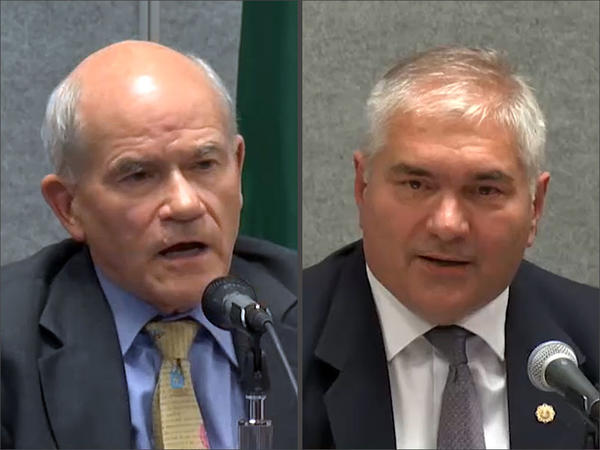 Washington Supreme Court Justice Charlie Wiggins, left, is facing an aggressive challenge for his seat from Federal Way Municipal Court Judge Dave Larson.