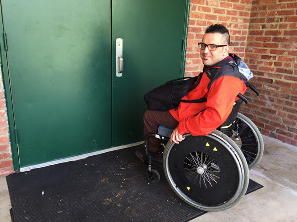 Ian Watlington, with the National Disability Rights Network, pauses at the doorway of a Washington, D.C., recreation center used as a polling place. He says the door, which has a stationary bar down the middle, would be too narrow for him to enter if he was in his motorized wheelchair. He can barely get through in his manual chair.
