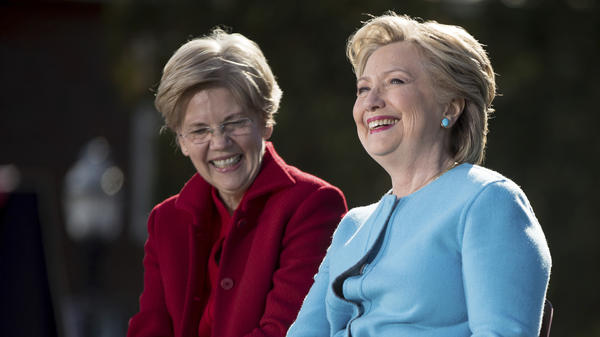 Hillary Clinton and Sen. Elizabeth Warren, D-Mass., attend a rally at Saint Anselm College in Manchester, N.H., on Monday.