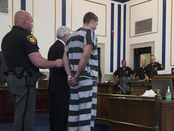 Former University of Cincinnati police officer Ray Tensing appears before Judge Megan Shanahan at Hamilton County Courthouse for his arraignment in the shooting death of motorist Samuel DuBose, July 30, 2015, in Cincinnati. Tensing pleaded not guilty to charges of murder and involuntary manslaughter.