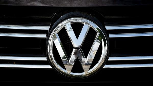 Volkswagen logos are visible at a dealership in Los Angeles on June 28. Volkswagen has agreed to pay out $14.7 billion in a settlement with U.S. authorities and car owners over its emissions-test-cheating diesel-powered cars. The settlement was approved on Tuesday.