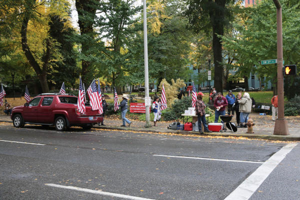 <p>Outside the U.S. District Courthouse in downtown Portland on Monday, a group of occupation supporters &mdash; and some of the defendants in the case &mdash; gathered to waive American flags and make signs.</p>