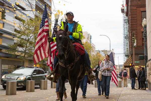<p>Occupation supporters (and a horse named Lady Liberty) marched around the block outside the federal courthouse in Portland following the verdict.</p>