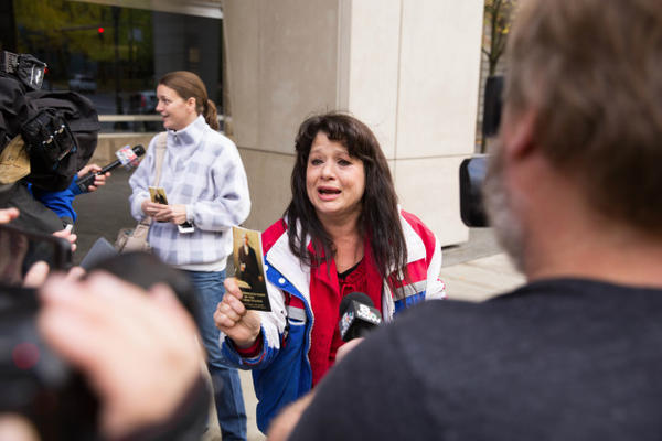 <p>Occupation supporter Maureen Valdez speaks to media holding a pocket Constitution following the deliverance of a not guilty verdict for seven defendants in the occupation of the Malheur National Wildlife Refuge.</p>