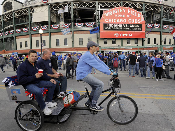 Fans arrive at Wrigley Field Friday before Game 3 of the World Series between the Chicago Cubs and the Cleveland Indians.