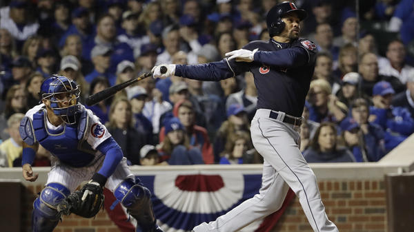 Cleveland's Coco Crisp hits the RBI single that allowed the Indians to beat the Cubs 1-0 in Game 3 of the World Series in Chicago on Friday. Cleveland leads the Series two games to one.