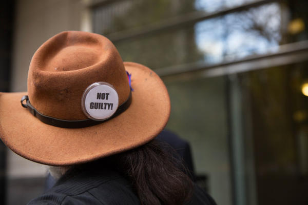 """<p>A supporter displays a """"NOT GUILTY!"""" button following the not guilty verdict delivered in the trial of seven occupiers of the Malheur National Wildlife Refuge.</p>"""